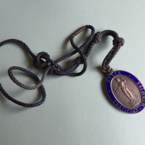 State Certified Midwife badge. This is the equivalent of the State Registered Nurse badge, but for midwives. Possibly on a cord for a community midwife who would visit patients at home.