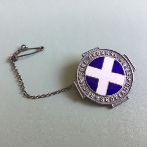 The Scottish RGN (Registered General Nurse) badge. This is the Scottish equivalent of the SRN given to English nurses.