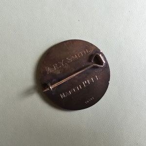 The nurses name is engraved on the back of the badge.